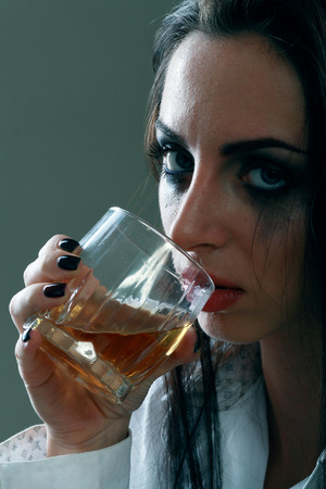 forlorn: Young crying woman in depression drink drinking alcohol