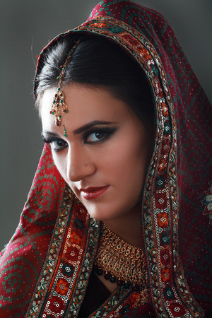 sexy bride: Indian beauty face close up, perfect make up. Series. young beautiful brunette in traditional national dress Stock Photo