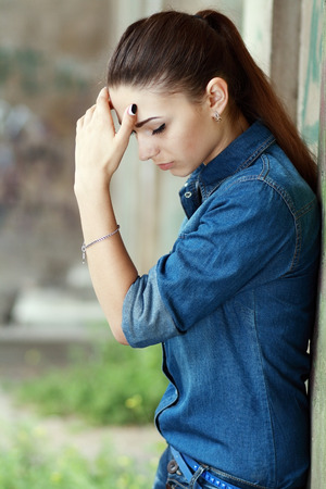 sobbing: Outdoor portrait of a sad teenage girl looking thoughtful about troubles Stock Photo