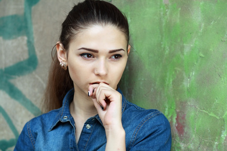 maltreatment: Outdoor portrait of a sad teenage girl looking thoughtful about troubles Stock Photo