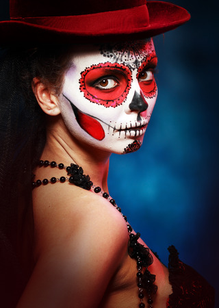 scary girl: Sugar skull girl in hat halloween concept Stock Photo