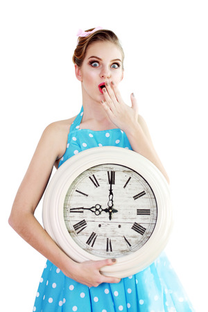 young woman holding a clock. time management concept. nine o`clock too late