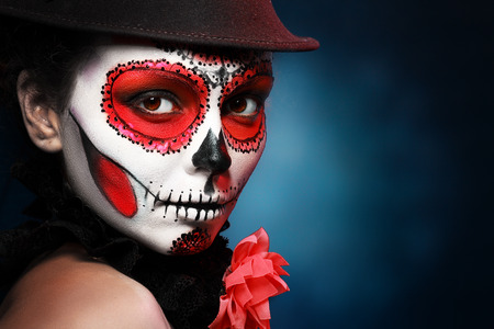 Sugar skull girl in hat, studio shot 版權商用圖片