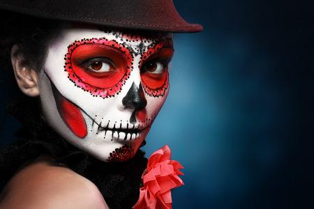 Sugar skull girl in hat, studio shot Archivio Fotografico