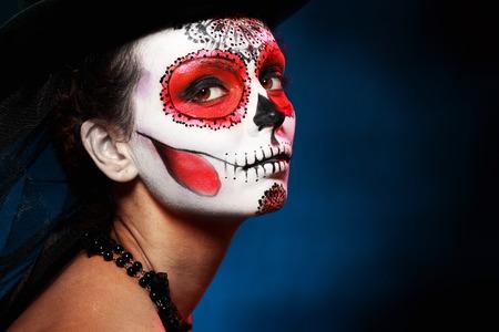 Sugar schedel meisje in hoed halloween-concept Stockfoto
