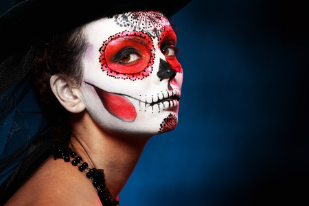 dead trees: Sugar skull girl in hat halloween concept Stock Photo