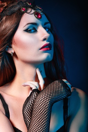 Portrait of mysterious woman perfect make up queen of the night photo