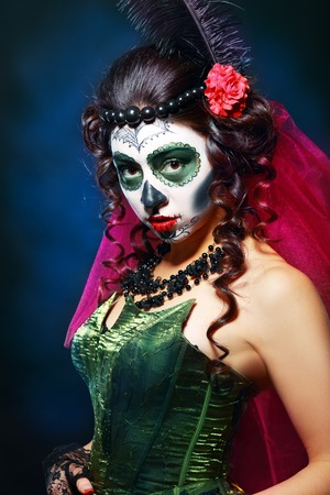 skull and flowers: halloween make up sugar skull beautiful model with perfect hairstyle. Santa Muerte concept.