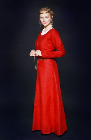 renaissance: Very beautiful woman in medieval red dress in studio look like a old time paynting looks like a queen