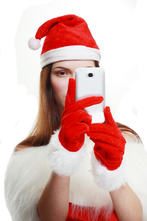 snegurochka: beautiful santa girl taking photgraph or selfy by her phone Stock Photo