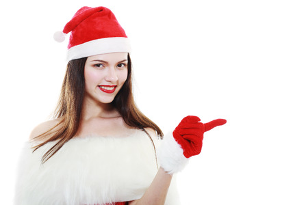 santa helper: christmas, x-mas, winter, happiness concept - smiling woman in santa helper hat pointing to something
