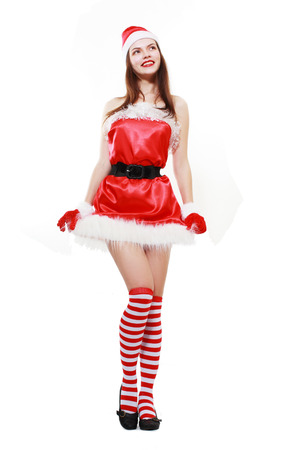 beautiful santa helper girl in stockings standing over white background photo