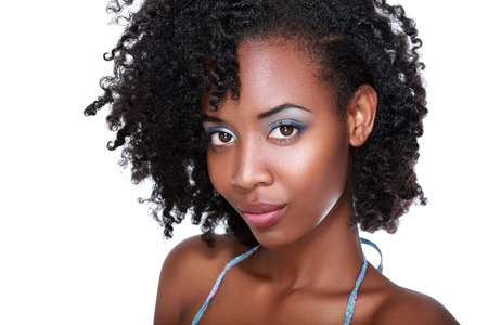 pretty woman face: Beautiful black woman face with perfect make up over white Stock Photo