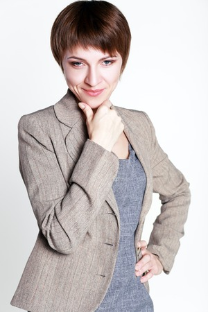 30 years old: 30 years old business woman thinking smiling and looking to the camera with suspecious look