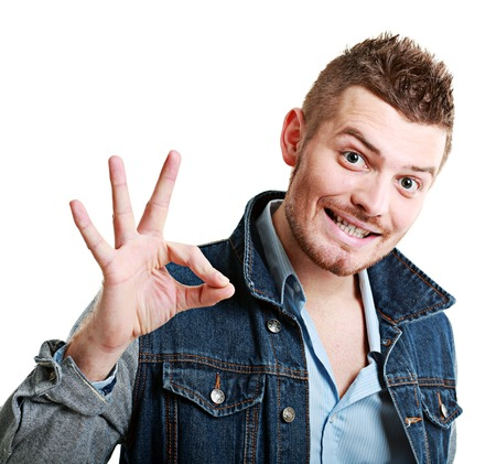 making face: Bearded man shows OK sign and making face - studio shoot