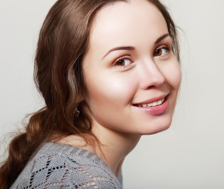 natural health: Natural health beauty of a woman face candid smiling Stock Photo