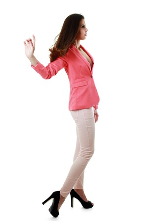 jacked: fashion model girl in pink jacked and light pink jeans posing in profile
