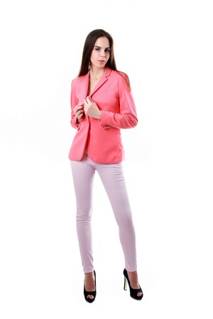 jacked: fashion model girl in pink jacked and light pink jeans posing Archivio Fotografico