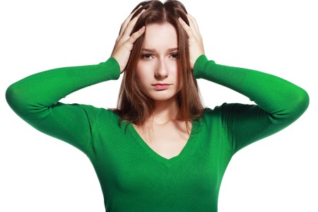 head pain: Young woman stressed have a head pain and feels Stock Photo