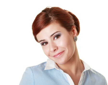ironic: Headshot of a young business woman with ironic smile Stock Photo