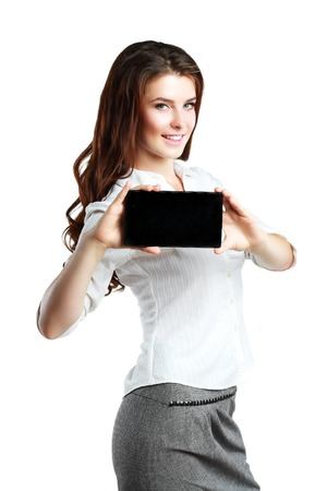 android tablet: Young and beautiful teenager girl holding an android tablet pc in her arms over grey background Stock Photo