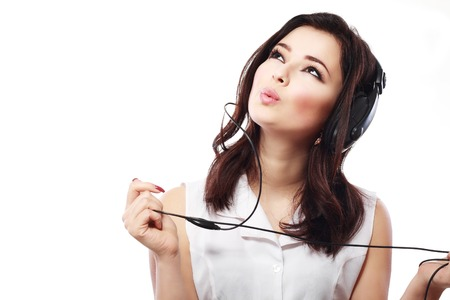 close up face: Young woman with headphones listening music close up face