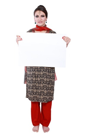 Cheerful traditional Indian woman holding a blank billboard Stock Photo