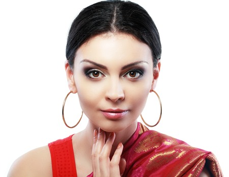 indian sweet: Pretty Indian girl portrait looking at the camera face close up Stock Photo