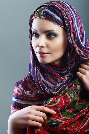 arab adult: Beautiful Arabic woman wearing head scarf