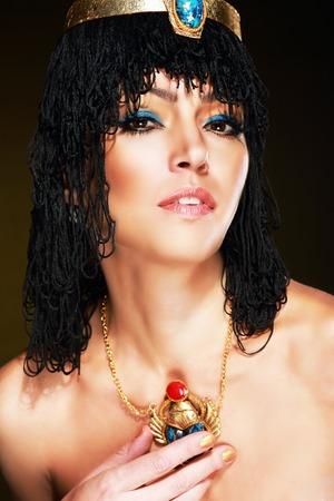 egyptian woman: Beautiful egyptian woman bronze portrait over grunge Stock Photo