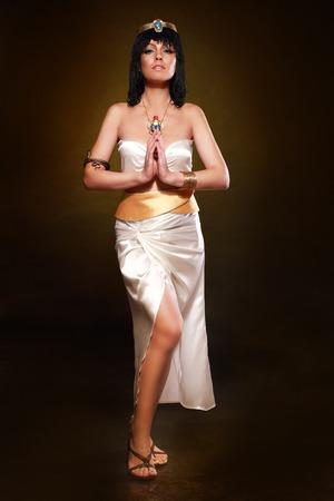 queen nefertiti: Beautiful egyptian woman bronze portrait over grunge Stock Photo