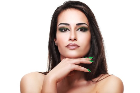 gir: Glamour portrait of beautiful woman model with green smoky makeup and dark hair, gipsy gir. Fashion shiny highlighter on skin Stock Photo