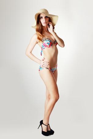 sunhat: Studio portrait of gorgeous model in bikini and sunhat. Fashion toning Stock Photo