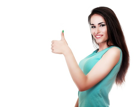 Gorgeous young brunette showing big thumbs up on white background. photo