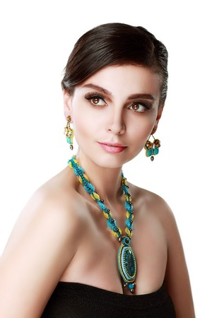 beauty shot: beautiful woman wearing butterfly earrings beauty shot close up