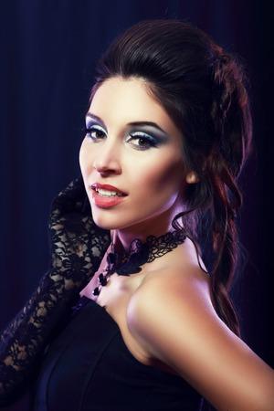 jabot: beautiful fashion vampire victorian style woman posing over dark background Stock Photo