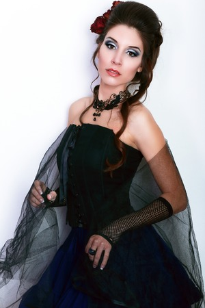 vamp: beautiful fashion vampire victorian style woman posing over dark background fashion toning