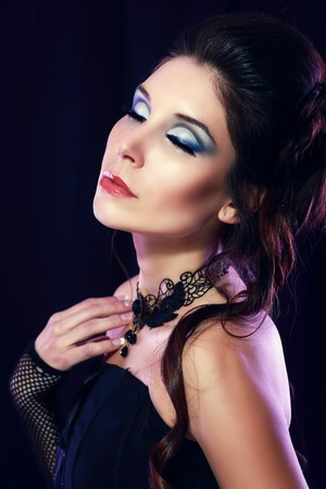 jabot: beautiful fashion vampire victorian style woman posing over dark background fashion toning