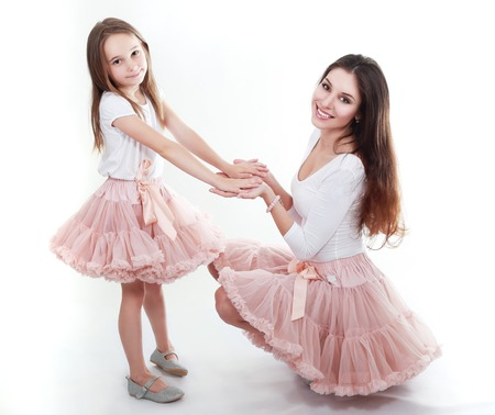 mother and daughter in same outfits posing on studio weared tutu skirts