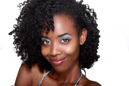 brown hair blue eyes: Beautiful african woman face with wide simle over white Stock Photo