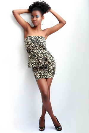 woman black: Beautiful young African American woman in black dress