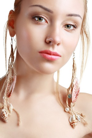 extravagancy: Peculiar Woman with Shell earrings close up beauty