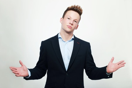 perplex: business men shrugging and cant explain Stock Photo