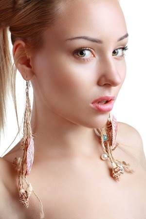 Peculiar Woman with Shell earrings close up beauty