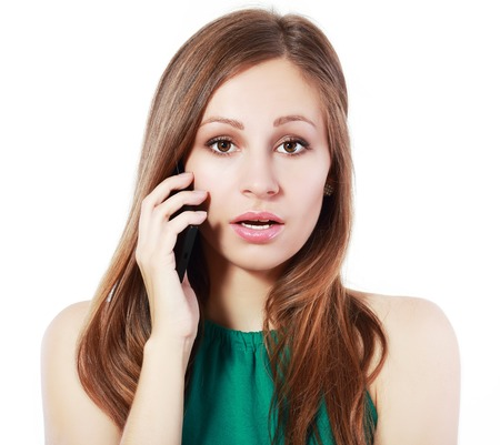 disbelieve: shocked woman looking at camera at disbelieve totaly upset and lost listening phone
