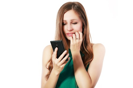 jolt: Young elegant woman talking on mobile phone against white background