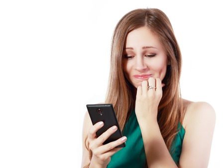 insulting: Young elegant woman talking on mobile phone against white background