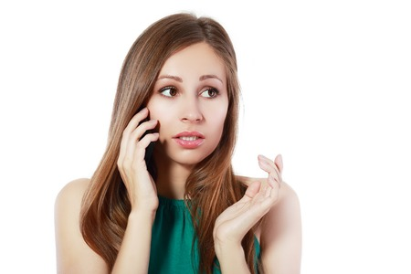insulting: Closeup portrait, upset young woman, shocked, scared, surprised, by what she sees on cell phone, bad news, isolated white background. Negative human emotions, facial expressions, feelings, reaction
