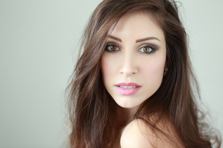 beautiful glamour portrait of brunette woman in natural light studio Stock Photo