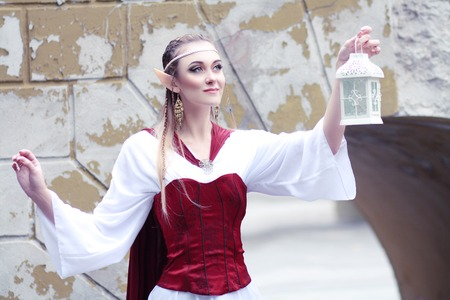 sexy christmas elf: Stylish portrait of a beautiful young girl elf princess magical fashion toning Stock Photo